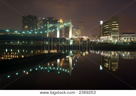 Minneapolis At Night Reflected In The Mississippi River With The 3Rd Avenue Bridge