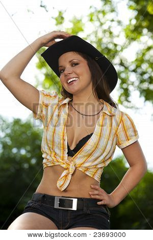 laughing woman with cowboy hat