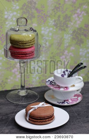 Espresso cups and three French macarons