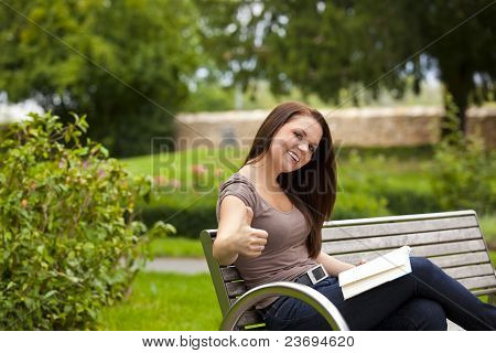 laughing woman posing thumbs up