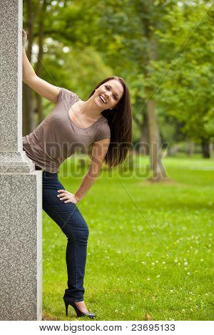 smiling woman posing in park