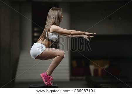 poster of Strong Sexy Athletic Young Girl Working Out In Gym