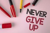 Conceptual Hand Writing Showing Never Give Up. Business Photo Text Be Persistent Motivate Yourself S poster
