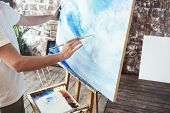 Process Of Drawing With Oilpaints And Paintbrush. Artist Paints On Canvas Painting On Easel In Studi poster