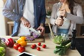 Closeup Of Couple Cooking Healthy Food Together In Their Loft Kitchen At Home. Preparing Vegetable S poster
