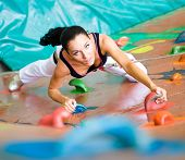 picture of climbing wall  - women climbing on a wall in an outdoor climbing center - JPG