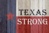 A Rustic Old Texas Strong Message, Texas Flag On Weathered Wood Background With Text Text Strong 3d  poster