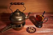 Still Life With A Brass Teapot That Is Located On A Coal Stand, A Glass With Tea, A Teaspoon, A Knif poster