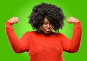 Beautiful african woman showing biceps expressing strength and gym concept, healthy life its good poster