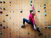 Fitness, Extreme Sport, Bouldering, People And Healthy Lifestyle Concept - Young Girl Exercising At  poster