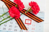 9 May Background With Three Red Carnations And St George Ribbon On The Calendar With Framed 9 May Da poster