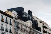 Luxury Residential Properties In Downtown District. Low Angle View Of Penthouses Against Cloudy Sky poster