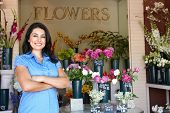 stock photo of flower shop  - Women standing outside florists - JPG