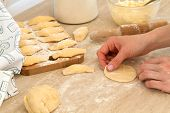 Douhg Preparation For Cooking Dumplings. Womens Hand Cutting Up Dough. Womens Hands In A Process Of  poster
