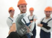 closeup. the wrench in the hands of the builders poster