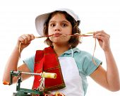 stock photo of snitch  - Preteen cook eating strands of apple peel she removed with an apple peeler - JPG