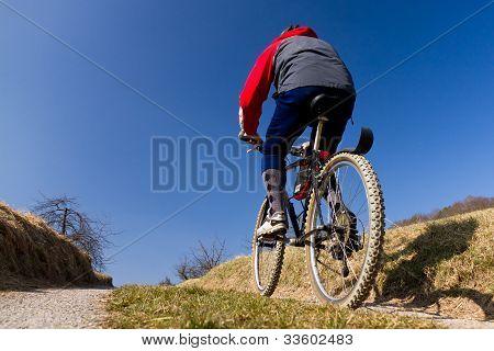 senior on a mountain bike