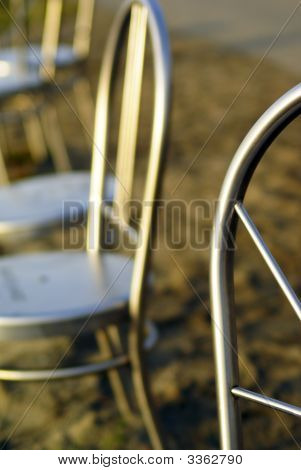 Abstract Of Metal Chairs On A Beach