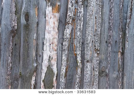 Unpainted rough wooden wall