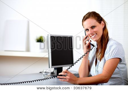 Friendly Blonde Secretary Speaking On Phone
