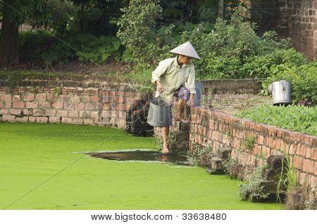 Vietnamese Woman getting water