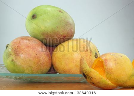 still life of fresh mangoes