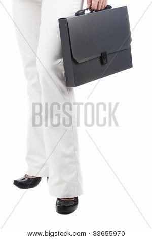 Fragment Shot Of A Business Woman Standing Towards To Viewer And Holiding Black Briefcase