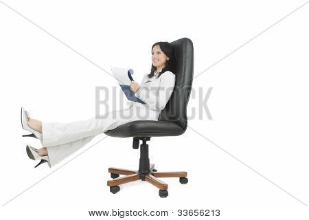 Woman In Business Chair Writing A Doc And Smiling With A Natural Smile