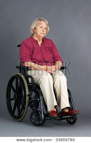 Sad Senior Woman In Wheelchair