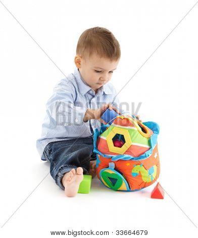 Cute baby enjoying colorful developmental toy.