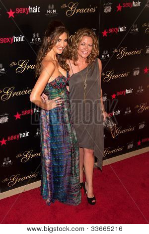 BEVERLY HILLS, CA - MAY 21: Heather McDonald and Sarah Colonna pose together at the Gracie Awards Gala on May 21, 2012 at the Beverly Hilton Hotel in Beverly Hills, California.