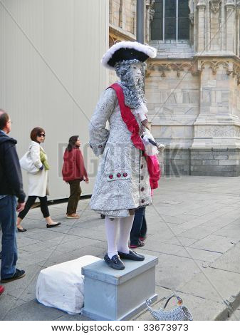 Human statue in historical attire, Milan