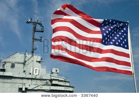 Flag And Aircraft Carrier