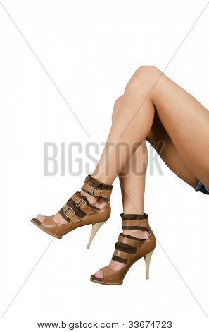 beautiful femail legs in shoes isolated on white