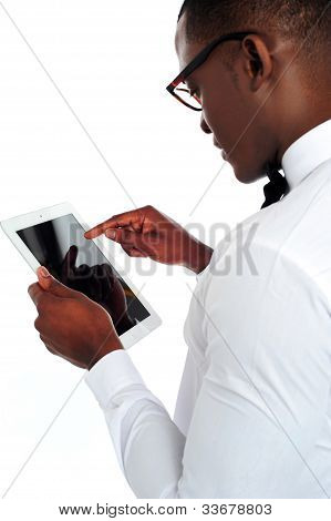 Rear-view Of African Holding A Touch-pad Device