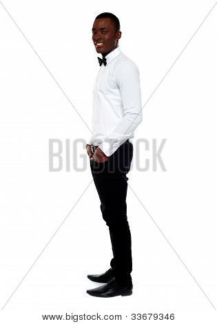 Full Length View Of Smart Young Man. Side Pose