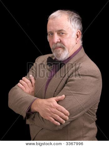 Older Businessman Looking Into Camera