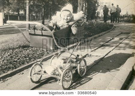 Vintage photo of baby in pram (fifties)
