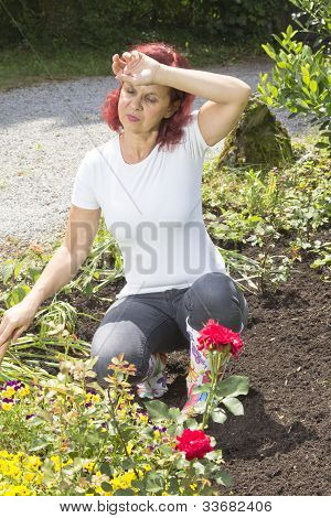 Exhausted woman gardener