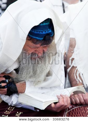 JERUSALEM, ISRAEL - APRIL 26: An unidentified Jewish man praying at the western wall on a jewish holiday Israel's 64th Independence Day on April 26, 2012 in Jerusalem, Israel