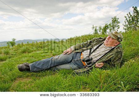 Senior birdwatcher in mountains