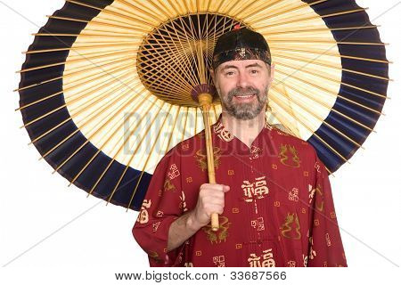 Europeans in traditional Chinese shirt holding an umbrella. Umbrella is made of bamboo and paper.