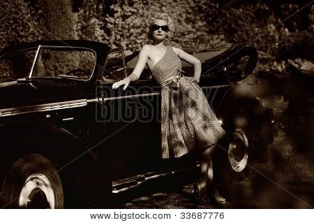 Woman near a retro car outdoors