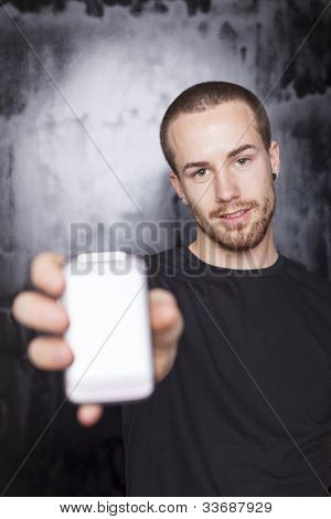 Men showing screen of smartphone, focus on face, black t-shirt and background, studio shot