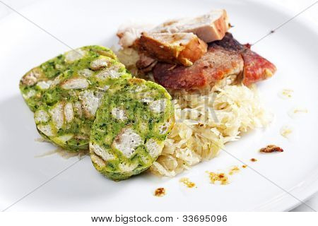 pork meat with herbal dumplings and cabbage