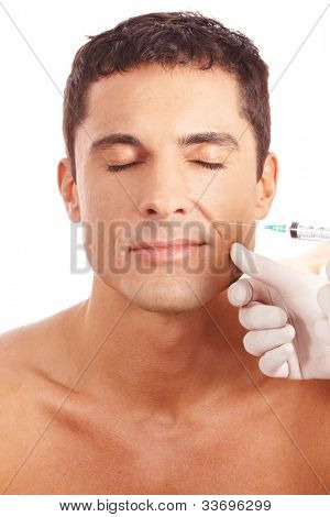 Attractive man getting wrinkle treatment with syringe