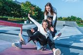 Three Teenage Girls Teenagers Ride Skateboard, Happy Have Fun Playing And Laughing, Summer Sports Gr poster