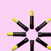 Set Of Yellow Lipstick Isolated Equalled A Circle On Pink Color Background. Colorful Tones, Lipstick poster