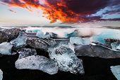 Ice Rock With Black Sand Beach At Jokulsarlon Beach. Diamond Beach In Iceland poster