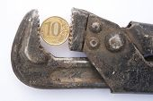 Russian Coin In The Gripper Wrench. Russian Ten-ruble Coin Is Clamped In A Wrench. The Concept Of Sa poster